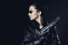Attractive female agent with raised gun stock photo