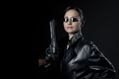 Attractive female agent with raised gun Stock Photography