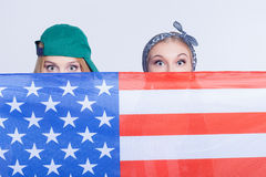 Attractive female American friends are making fun Royalty Free Stock Photo