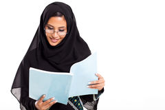 Arabian student reading. Attractive female Arabian college student reading book isolated on white Royalty Free Stock Photos