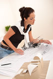 Attractive female architect watching plans Royalty Free Stock Photo