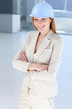 Attractive female architect wearing a hard hat Royalty Free Stock Image