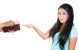 Attractive female asking for money, guy is handing out dollars to her from brown wallet Stock Image