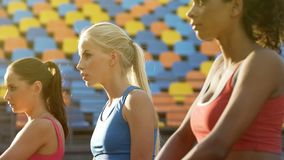 Attractive female athletes waiting for competitions, rivals determined to win stock photos