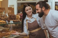 Bearded handsome man shopping at the local bakery stock images