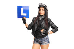 Attractive female biker holding an L-sign Stock Photos