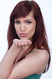 Attractive female blowing you a kiss Royalty Free Stock Photography