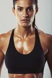 Attractive female bodybuilder posing confidently Stock Photo