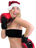 Attractive female boxer in santa style Stock Photography