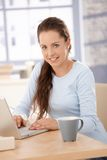 Attractive female browsing internet at home Royalty Free Stock Photo