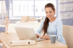 Attractive female browsing internet at home Royalty Free Stock Image