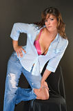 Attractive female brunette in jeans and open shirt Royalty Free Stock Images