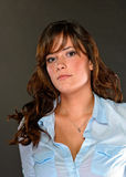 Attractive female brunette looking at camera Royalty Free Stock Photography