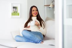 Attractive female business woman taking a break after long day with a book and cup of coffee royalty free stock photo