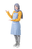 Attractive female cafe worker with hijab presenting to copyspace Royalty Free Stock Photography