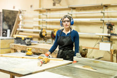 Attractive female carpenter at work Royalty Free Stock Photo