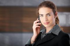 Attractive female with cellphone Royalty Free Stock Images