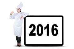 Attractive Female Chef Showing Thumb Up Stock Photo