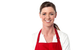 Attractive female chef wearing red apron Stock Photo
