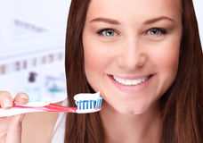 Attractive female clean teeth Stock Photos