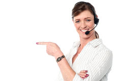 Attractive female customer support staff Royalty Free Stock Image