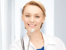 Attractive female dentist with tools Stock Photo