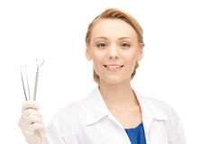 Attractive female dentist with tools Royalty Free Stock Image