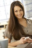 Attractive female dialing on mobilephone Stock Photography