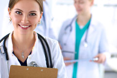 Attractive female doctor  with folder in front of Stock Photography