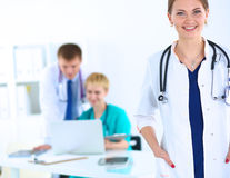 Attractive female doctor in front of medical group Royalty Free Stock Image