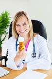 Attractive female doctor holding pills Royalty Free Stock Images