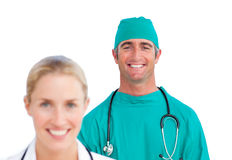 Attractive female doctor and a mature surgeon Stock Photos