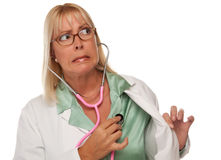 Attractive Female Doctor or Nurse Checking Heart. Attractive Female Doctor or Nurse Checking Her Own Heart Isolated on a White Background stock photo