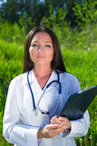 Attractive female doctor outdoors Royalty Free Stock Image