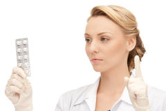 Attractive female doctor with pills Stock Photography