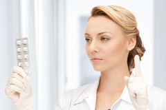 Attractive female doctor with pills Stock Images