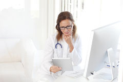 Attractive female doctor Stock Images