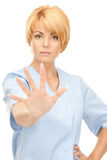 Attractive female doctor showing stop gesture Royalty Free Stock Photos