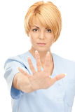 Attractive female doctor showing stop gesture Royalty Free Stock Image