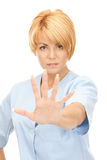 Attractive female doctor showing stop gesture Stock Images