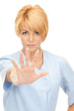 Attractive female doctor showing stop gesture Royalty Free Stock Photography