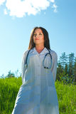 Attractive female doctor staying outdoors Royalty Free Stock Photos
