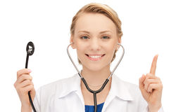 Attractive female doctor with stethoscope Royalty Free Stock Images