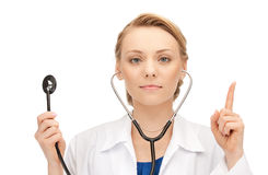 Attractive female doctor with stethoscope Stock Photo