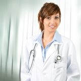 Attractive  female doctor with stethoscope. Stock Photo