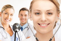 Attractive female doctor with stethoscope Royalty Free Stock Photography