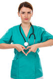 Attractive female doctor with stethoscope making heart shape Royalty Free Stock Images