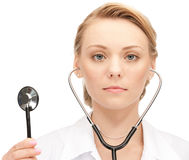 Attractive female doctor with stethoscope Stock Photos