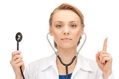 Attractive female doctor with stethoscope Stock Image