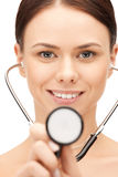 Attractive female doctor with stethoscope Stock Photography
